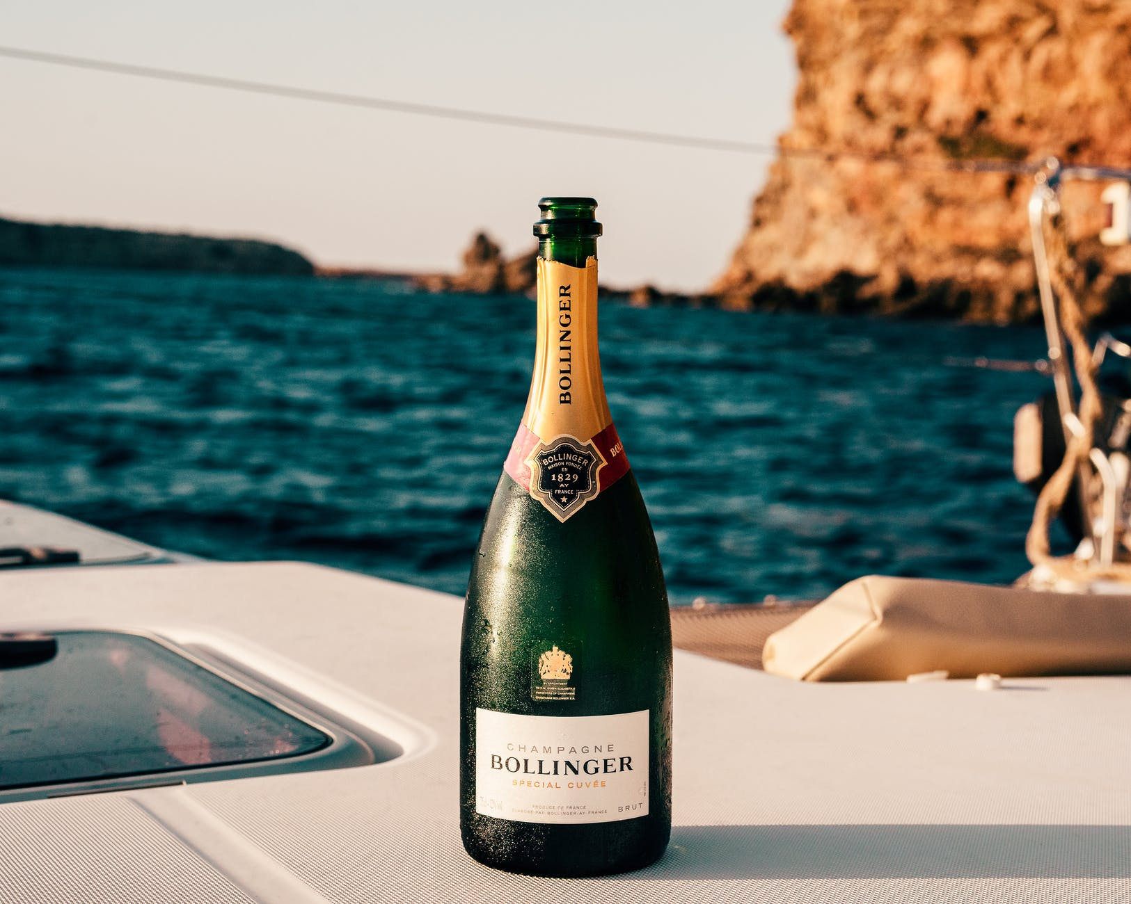 bollinger wine bottle on boat